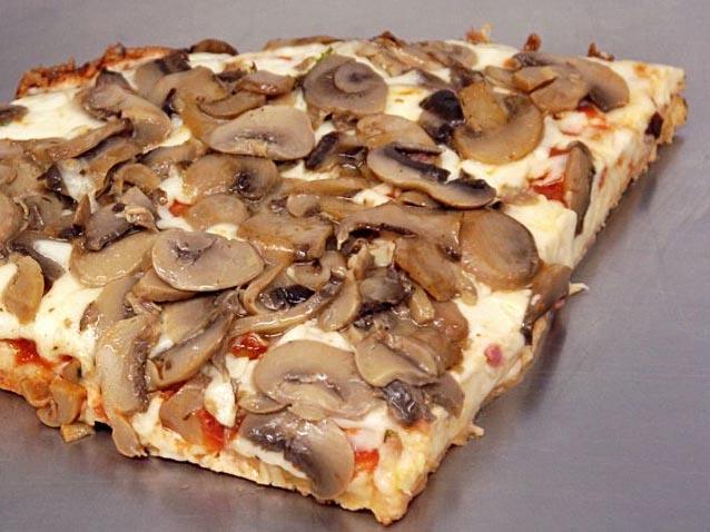 Homemade Pizza with smoked mozzarella and mushrooms